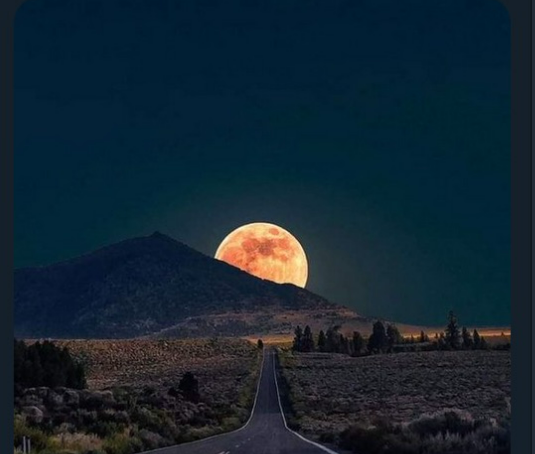 Fake image of a huge moon setting.