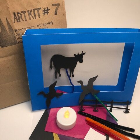 Art kit with blue frame and shadow puppets
