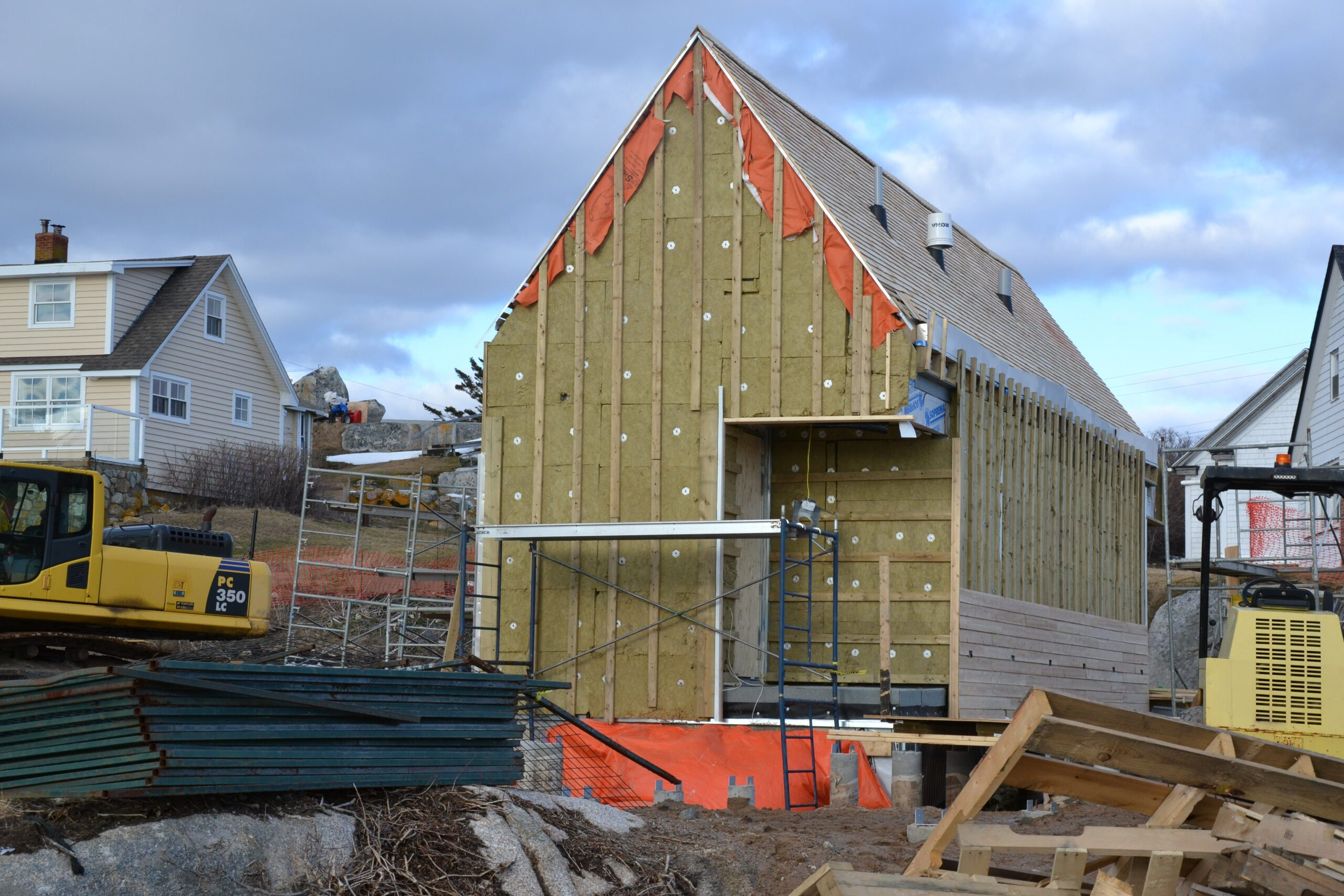 Wooden building with a sharply pitched roof under construction
