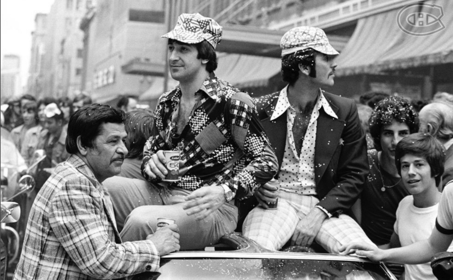 Two men on a float in absurd 1970s outfits