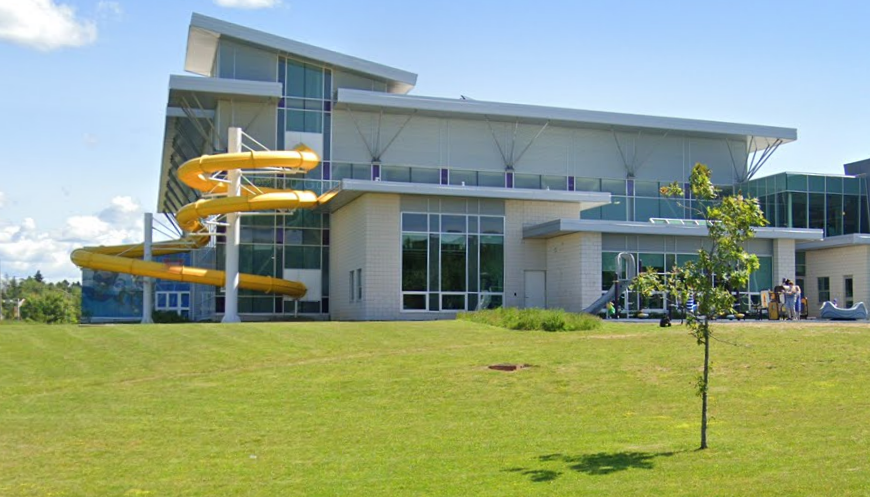 Building with a curly yellow waterslide on the outside