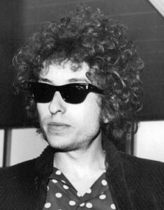 Black-and-white closeup of Bob Dylan, probably in his 30s.
