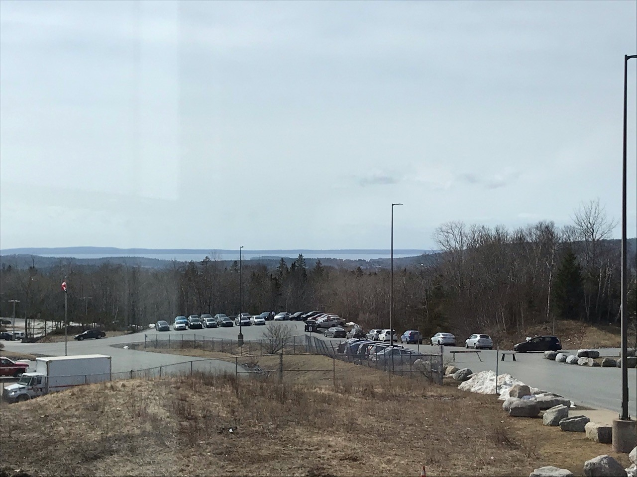 Parking lot with ocean in the background
