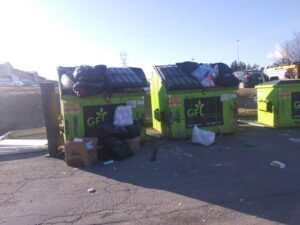 Dumpsters overflowing with garbage