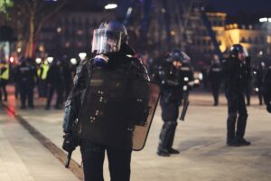 Police officer in riot gear, with gas mask