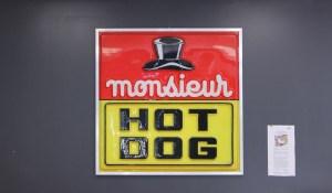 Sign saying Monsieur Hot Dog