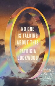 The book cover for Patricia Lockwood's book No One Is Talking About This. It's a lovely photoshopped illustration of a twisted translucent ring, floating in midair, with a sunset, light clouds, and a rainbow all at once, and the book's title and author's name are in the center of the ring.