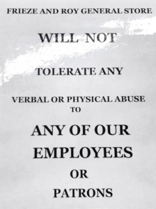 A laminated sign at Frieze and Roy General store warns customers about abusive behavior.