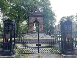 The entrance to the Old Burying Grounds, with its wrought iron gates and fence.