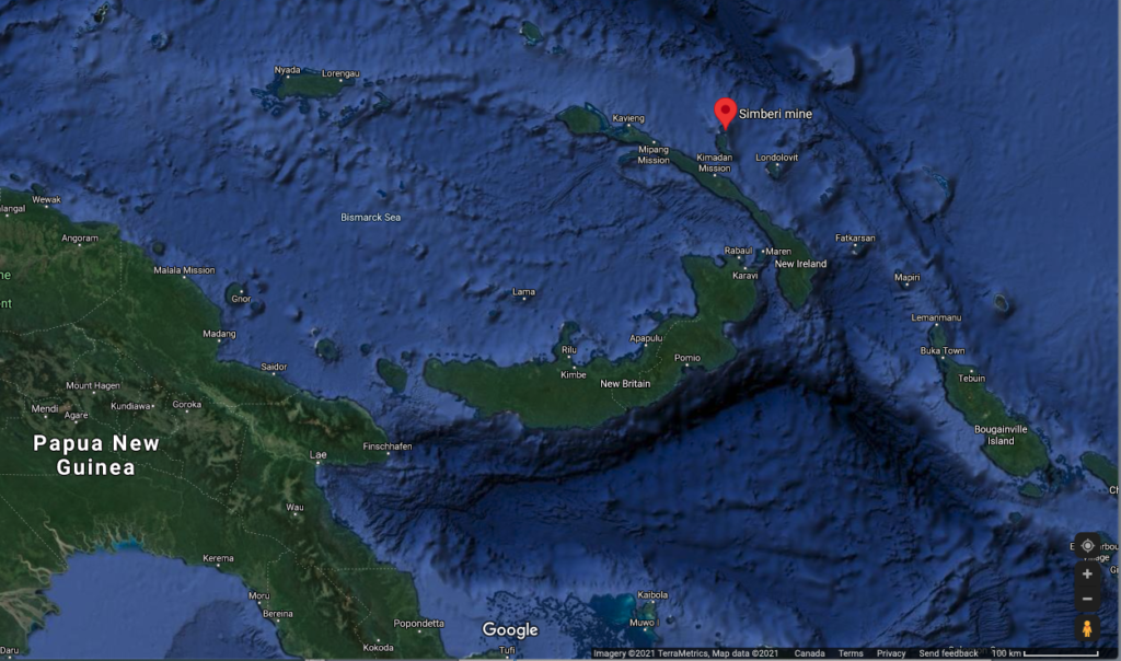 A Google map image showing the red marker of the St Barbara Simberi mine in Papua New Guinea. The islands are a dark green against the deep blue of the ocean.