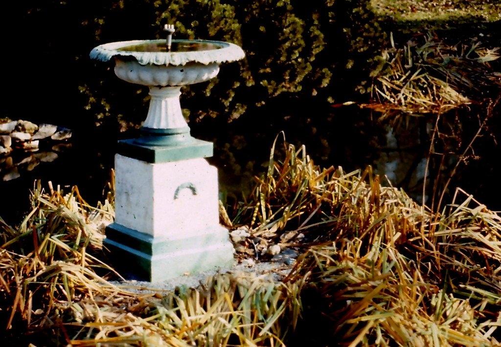 Dilapidated simple cast-iron fountain