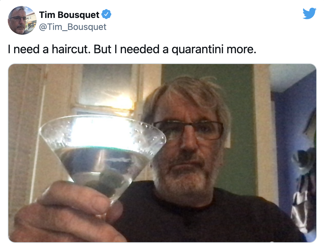 A screenshot of Tim's recent twitter post, in which he's holding a Quarantini up to the camera. It's got two olives in it. His hair is flopping over his forehead, and he looks like he's seriously considering just downing his drink.