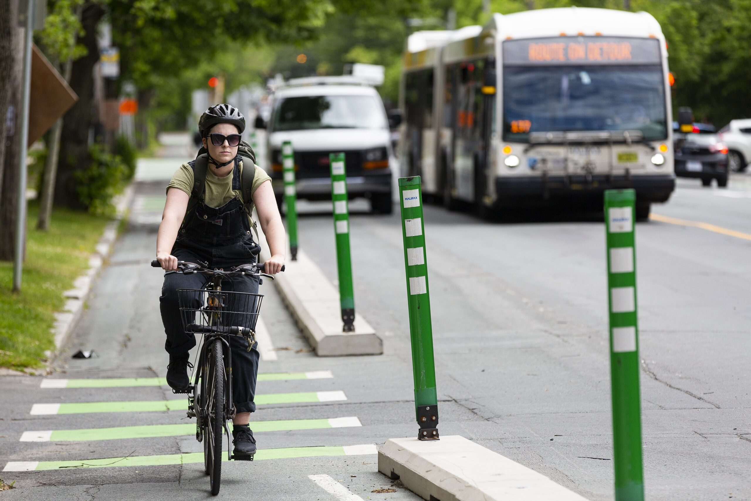 A cyclist travels in the South Park Street bike lane in Halifax in June 2021. they're heading north to Spring Garden Road.