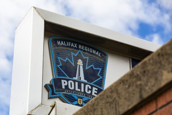 A close up of the HRP crest on the sign for the Halifax Regional Police headquarters on Gottingen Street in June 2021.