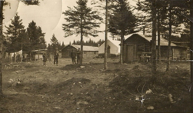 Black-and-white photo of a work camp