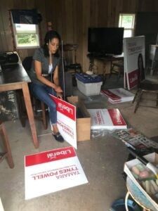 Tamara Tynes Powell preparing a stack of campaign signs