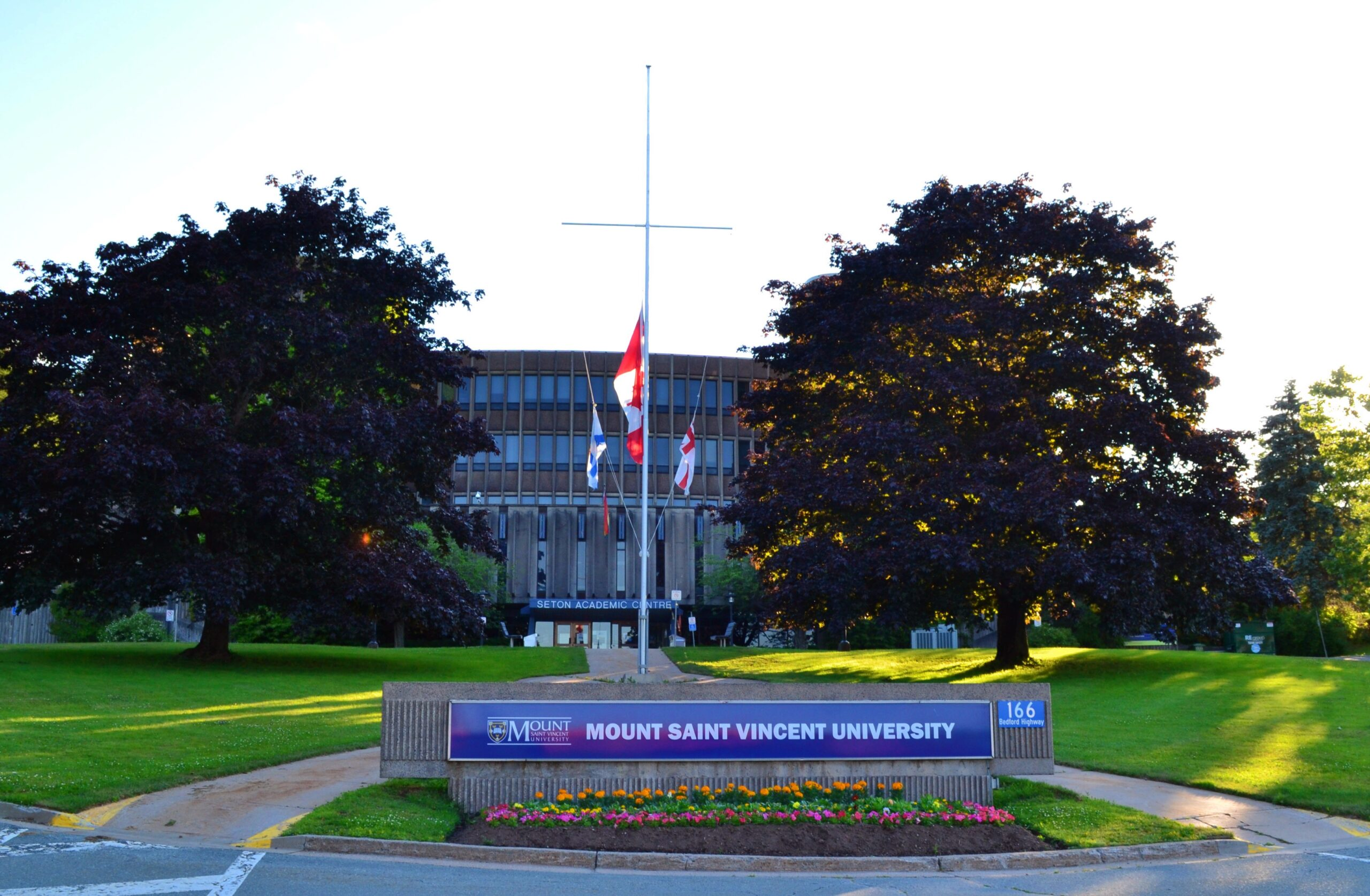 The Mount Saint Vincent University sign in front of the university's Seton Academic Building.