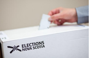 Hand holding a ballot and putting it in a box marked Elections Nova Scotia