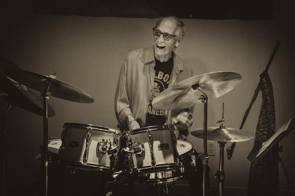 Drummer in his 70s enjoying playing