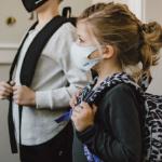 Children wearing masks getting ready for school
