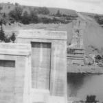 The unfinished concrete supports for a railroad bridge over a river