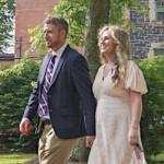 Iain Rankin and his wife walk down a driveway