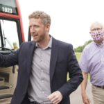 Iain Rankin and a masked man just got off the Liberal bus