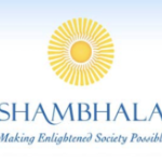 The Shambhala logo, which is a yellow stylized sun on a pale blue sky