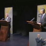 A screenshot of two of the contestants in the leaders debate, with the sign language interpreter trying to make sense of it.