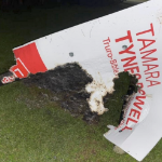 A burned campaign sign belonging to Tamara Tynes Powell