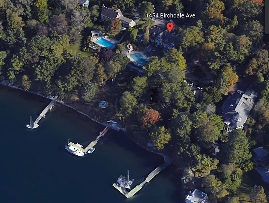 Google Earth image from the air, showing a heavily treed area and shoreline with docks. Two swimming pools are visible, along with a pin marking the location of 1454 Birchdale Avenue.