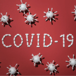 COVID 10 spelled out in white pills on a red background.
