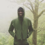 Chúk Odenigbo in the woods on a foggy day.