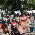 A group of protesters on a sunny day