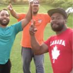 Three Black men playing golf and wearing bright Tshirts