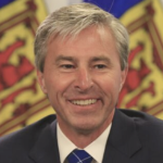 Premier elect Tim Houston smiles as if he hasn't a problem in the world
