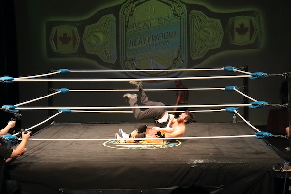 Covey Christ wrestles with the ref in the center of the ring
