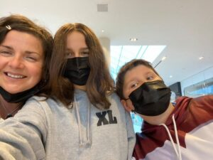 A photo of Leona Burkey with her daughter Maggie and son Zack. Maggie and Zack are wearing black masks.