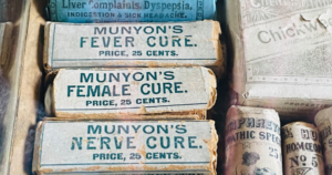 A selection of old paper packages of Munyon's dubious cures.