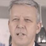 John Lohr, squinting as he explains something