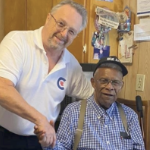 Steven Cotter, a white CPC candidate, shakes the hand of Foster Elms, a Black resident of New Glasgow.