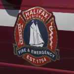 The Halifax Regional Fire and Emergency crest on the side of a vehicle.