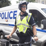 A Halifax police officer holds on to his bike