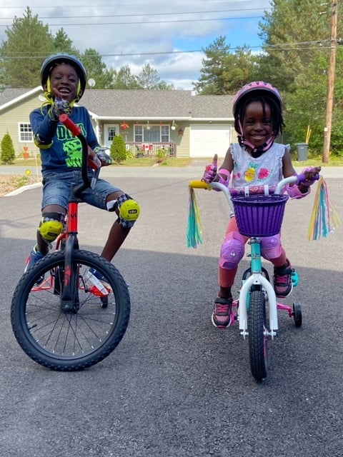 Adwoa and Kwabena, were surprised with new bicycles from Middleton couple Bonnie Morine and Bob Clattenburg. Photo: Mid Valley Region Physician Recruitment & Retention / Facebook.