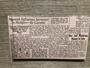 """A photo of a newspaper clipping from about 100 years ago with the headline """"Spanish Influenza Increases in Halfax -- Be Careful."""""""