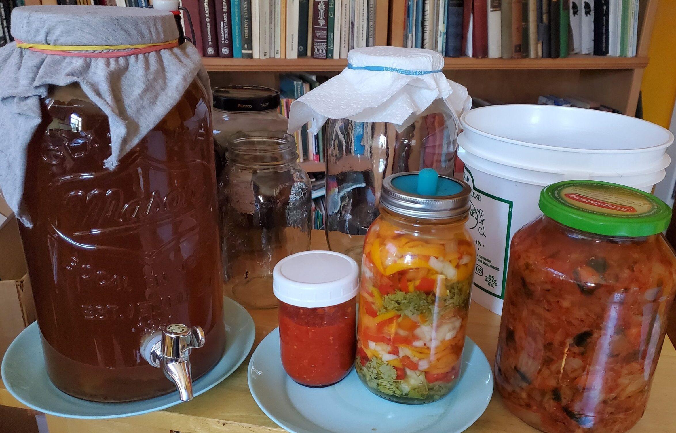 Sideboard with jars of pickles, hot sauce, kimchi and kombucha