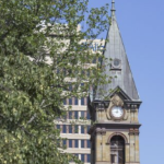 The clock at City Hall on a clear August day in 2020